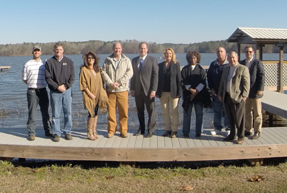 Grant presentation: Guests at a grant presentation ceremony at Higgins Ferry Park included Park Ranger Derek Collum, Park Director Gerald Arrington, County Administrator Connie Powell, County Commissioner Joe Headley, State Sen. Cam Ward, Cawaco representative Patti Penington, Jessie Binion and Jackie Baker of West End Neighborhood Watch, Industrial Development Coordinator Fred Crawford and Drayton Cosby with Cawaco.