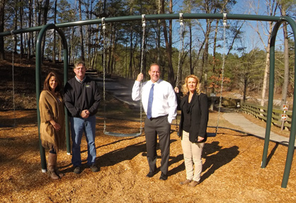 New equipment: Powell, Arrington, Ward and Penington stand with the newly built playground at Minooka Park.