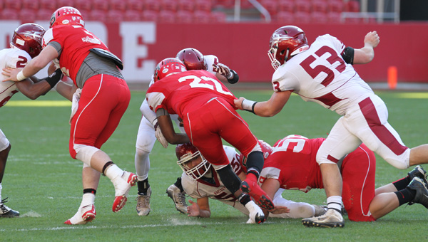 Nowhere to run: The Maplesville defense, including Will Harrison (No. 53), stops Cedar Bluff's Ivory Starr on Thursday. (Photo by Brandon Sumrall)