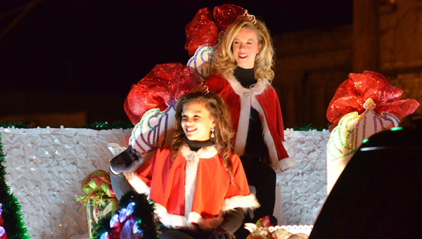 Christmas spirit: Chilton County Peach Queens Halle Sullivan and Grayson Gann wave to attendees of the annual Clanton Christmas parade on Dec. 4. The parade, which is sponsored by the Rotary Club of Chilton County, wound its way through downtown Clanton featuring about 90 entries and hundreds of spectators. (Photos by Stephen Dawkins)