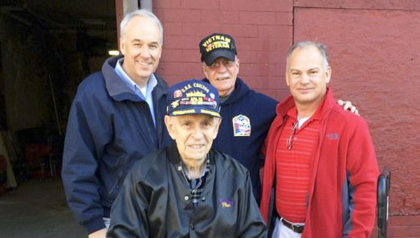 Billy Singleton (back, left) and Tony Wearren (back, right) traveled from Chilton County to Stapleton, Staten Island New York to retrieve the USS Chilton. Singleton and Wearren are pictured with John Bottone Jr. (center) and John Bottone (seated).  (Contributed)
