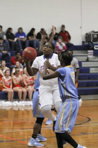 Lexis Blackmon finds an opening down while driving into the paint against Selma on Tuesday. (Photo by Brandon Sumrall / Special)