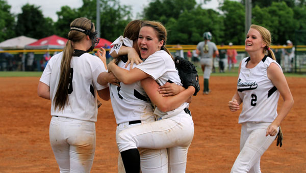 Isabella's Hailey and Sophia Underwood celebrate a win over Athens Bible that earned the Mustangs a berth in the championship round of the Class 1A state softball tournament Friday at Lagoon Park in Montgomery. (Photo on File)