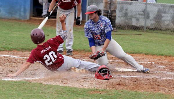 Verbena's Taylor Deavers (right) tags out Maplesville's Thomas Schoener at home plate on Saturday in a first-round baseball playoff game. (Photo on File)