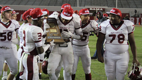 Maplesville players celebrate Thursday's win over Cedar Bluff in the Class 1A state championship game. (Photos on File)