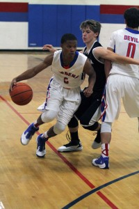 Verbena's Dorrian Parker looks for a path around a screen set by Tristan Short.