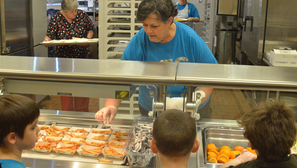 Lunch is served: Donya Johnson serves lunch to students at Clanton Elementary School. (Photos by Stephen Dawkins)