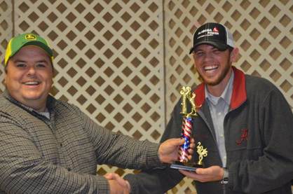 Pre-hunt fun: Chad Tillery and Travis Burnett have some pre-hunt fun with the trophy Ty Byrd won last year.