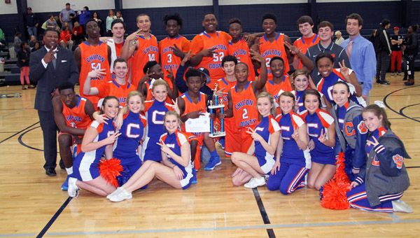 The CCHS boys basketball team poses with the trophy after a hard fought battle against rival Jemison in the county title game. (Photo by Brandon Sumrall / Special)