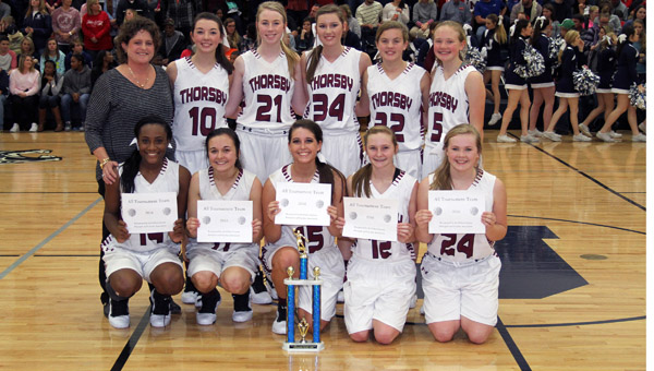 The Thorsby girls basketball team poses with the county tournament trophy after defeating Isabella in the final game. (Photo by Brandon Sumrall / Special)