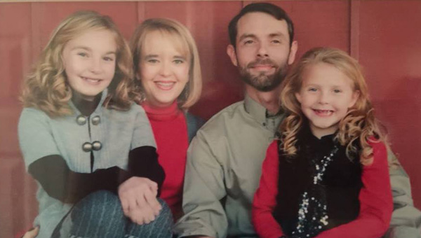 Family ties: The Alexander family includes Isabella, Kelli, John and Abi. (Contributed photos)