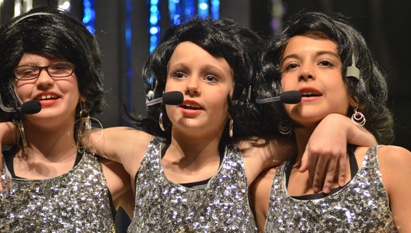 """Young stars: Amelia Fjeldstad, Addyson Williams and Makayla Logan perform """"Dancing in the Street"""" by Martha Reeves and the Vandellas on Feb. 26 during Isabella School's 12th annual """"Motown"""" production. (Photos by Stephen Dawkins)"""