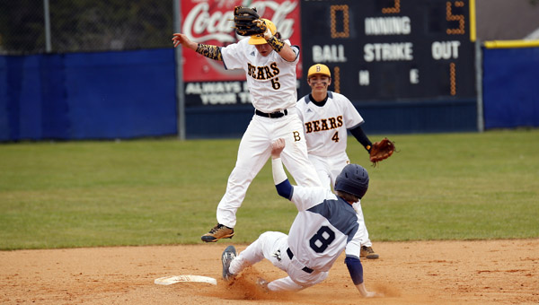 Austin Moore of Jemison (No. 8) slides under the tag attempt of a leaping Noah Godwin of Billingsley (No. 6) during the Jemison Baseball Invitational on Saturday. (Photo by Brandon Sumrall / Special)