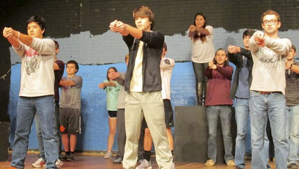 Alex McCord, Antonio Garcia, Landon Powell, Colby Barron, Magdalena Henriquez, Kevin Williams, Logan Easterling, Ryan Scott, Clayton Collum and Chloe Hunt practice a song during a rehearsal.