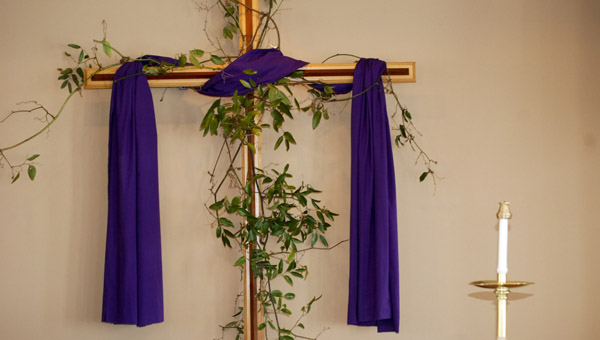 A purple cloth is draped around the cross that sits behind the altar at Trinity Episcopal Church. Purple is the color associated with Lent. (Photo by Anthony Richards / Advertiser)