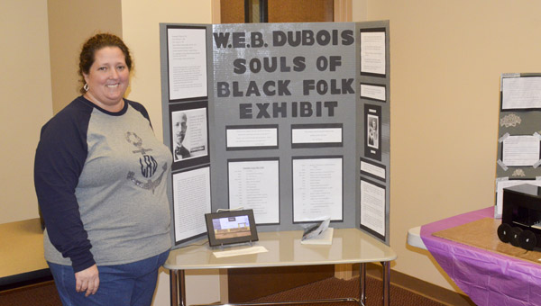 "Jefferson State Community College student Lori Rickerd stands next to the exhibit about the book ""Souls of Black Folk"" written by W. E. B. Du Bois. Rickerd was a member of the group of students that created the exhibit. (Photo by Anthony Richards / Advertiser)"