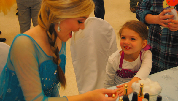"""Meet a princess: Amelia Wilkinson (right) gets a manicure from """"Elsa"""" (Miss Chilton County Avery Wyatt) on Feb. 12 during the fourth annual Jemison Fairytale Show event at Jemison Municipal Complex.  (Photos by Robyn Keller)"""