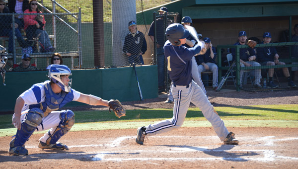 Will Lenoir of Jemison drives in two runs with a base hit against Chilton County High School during Game 2 of a doubleheader on Saturday. (Photo by Brian Millican / Special)