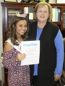 "Miss Jefferson State Hannah Tierce meets with Jemison High School Principal Diane Calloway to talk to her about the ""Spring Into Giving"" clothing drive. The drive began in March and will go until April 22 to benefit Raleigh's Place Clothes Closet."
