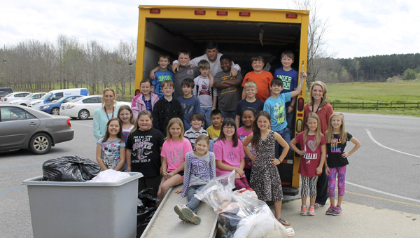 "Courtney Epperson's third grade class at Isabella School recently donated 1,503 items of clothing to the ""Spring Into Giving"" clothing drive. Miss Jefferson State Hannah Tierce came up with the idea for the clothing drive."