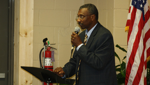Grand re-opening: Wendell Saxon, contributor to the West End Neighborhood Watch program, speaks at a re-opening ceremony for the E.M. Henry Community Center. (Contributed photo)