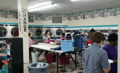 Quarters for everyone: Trinity provided free laundry for customers during the outreach.