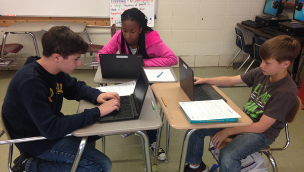 School work: Kirkland Robinson, Bryce Burns-Devers and Joseph Johnson use some of the Google Chromebooks that were purchased for their class because of donations and a grant. (Photos by Leisl Lemire)