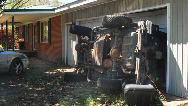 A Jeep Wrangler left the roadway and struck a house off Thrash Road on Tuesday. (Photo by Stephen Dawkins)