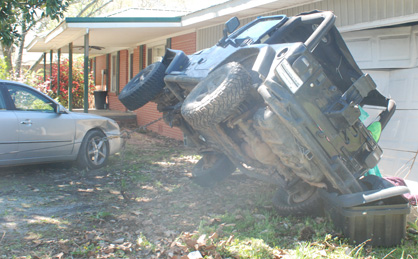 A wrecker service removes the vehicle from the property.