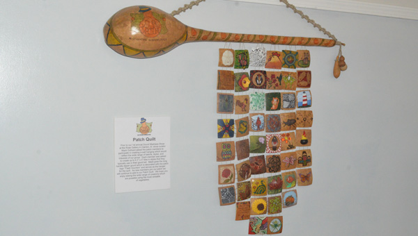 """Patch quilt: One of the centerpieces on display at this year's March Gourd Madness is a """"patch quilt"""" that comprises many smaller pieces of artwork, each one by a different local artist. Other examples of gourd artwork (below) include pieces with chalkboards for messages, a chicken and eggs, and a Native American dreamcatcher. (Photos by Scott Mims)"""