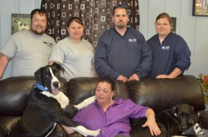 Joseph and Kristen Allgood, Mitchell Keener, Michelle Glass (back row) and Lisa Kromer (front row) have helped take care of the Great Danes since the wreck in January. Keener and Glass worked the scene of the wreck and helped rescue the dogs.