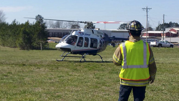 A landing zone was established on the corner of County Road 73 and County Road 50 after a female partially severed her hand on a wood chipper Monday morning. (CONTRIBUTED PHOTO)
