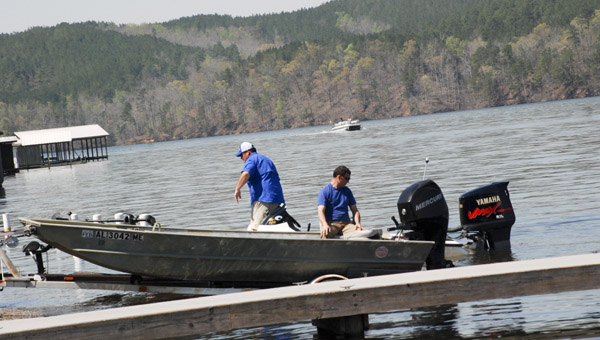 The Higgins Ferry Park boat ramp is a busy spot this time of year. Fishermen come from surrounding areas to participate in weekly tournaments. (Photo by Anthony Richards / Advertiser)