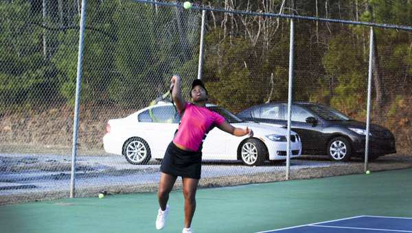 Ada Ruth Huntley of CCHS waits for the ball to come down prior to serving during a tennis match against Jemison's Sarah Price on Monday. (Photo by Anthony Richards / Advertiser)