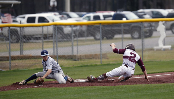 Conner McRae of Thorsby slides safely into third base, as the throw drifts wide in a game on Saturday against Calera High School. (Photo by Brandon Sumrall / Special)