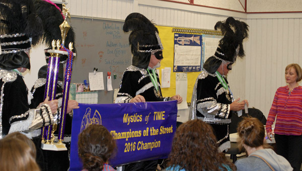 Members of the Mystics of Time Mardi Gras Organization on Wednesday presented the Verbena Marching Band with first place from this year's celebration. (Photo by Anthony Richards / Advertiser)