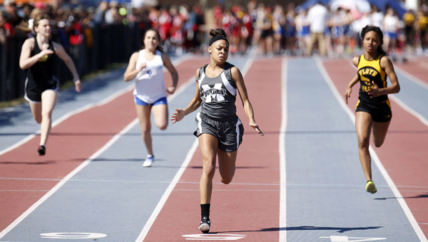 Janiya Moore crosses the finish line ahead of the pack to win the Junior High 100 Meter Dash during the Race to Fight Hunger event in Montgomery on Saturday. (Photo by Brandon Sumrall / Special)