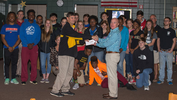 "Van Forrester (left) of Alabama Power presents Billingsley Athletic Director Tyson McLean and the Billingsley track team with a check for $2,500 thanks to the Alabama Power ""Power to Play"" program. (Photo by Brandon Sumrall / Special)"