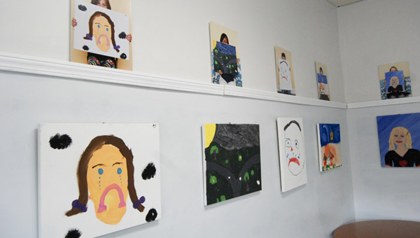 Paintings from 20 children line the walls of the Rose Gallery during April in conjunction with Child Abuse Awareness Month. (Photo by Anthony Richards / Advertiser)