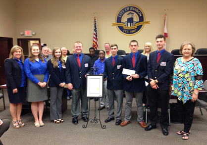 Job well done: Members of the Jemison High School robotics team, sponsors and administrators were on hand for the presentation of a proclamation from the Jemison City Council at Monday's meeting.