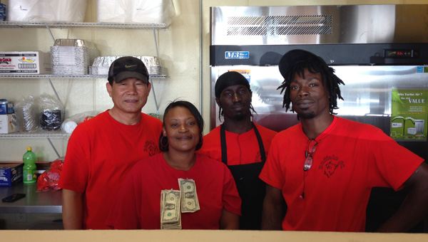 Restaurant staff: Charlie Chong (far left), owner of new Clanton restaurant Buffalo Street, is pictured with employees Leslie Childers, Clarence Ellis and Cameo Jackson. (Photos by Leisl Lemire)