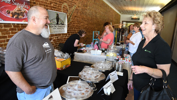 Pie prattle: Eulene Hollon (right) talks about pies with Pies by Mike owner Mike Graham during the Downtown Peach Market on Friday at Elizabeth Hall in Clanton. (Photos by Stephen Dawkins)