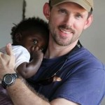 Display of love: Myron West, shown with an Acholi child, died June 21 at the age of 45 after a battle with the after-effects of malaria, a bacterial infection and double pneumonia.