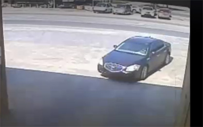 Getaway car: Surveillance video captured images of the subject and a black four-door vehicle he was driving.