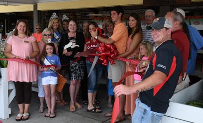 Open season: A ceremonial ribbon was cut at Durbin Farms Market in Clanton on Friday to declare peach season open in Chilton County.