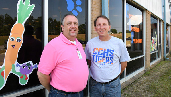 New look: Clanton Intermediate School Assistant Principal Roger Sheffield (left) and former Principal Mark Stephenson helped the school obtain funding for a project to tint the cafeteria windows. (Photo by Stephen Dawkins)