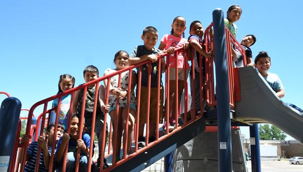 Break time: Students at the Clanton Elementary School summer camp take a break to enjoy the school playground. (Photos by Stephen Dawkins)