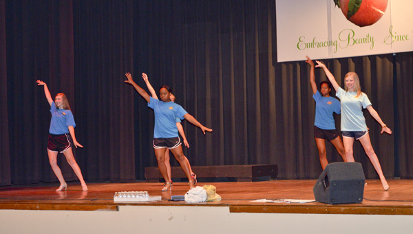 Participants in the 2016 Chilton County Distinguished Young Women program practice on Wednesday leading up to the event at the Chilton County High School auditorium. (Photo by Anthony Richards)