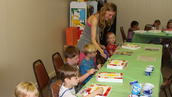 Learning art: Julie Harrison instructs students during last year's summer art camp.
