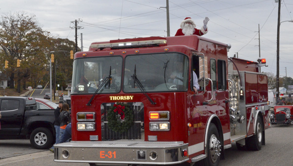 The Thorsby Fire Department gave Santa a ride during the annual Thorsby Christmas Parade on Saturday. (Photos by Anthony Richards)